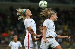 Julie Johnston and Allie Long to head the ball in!