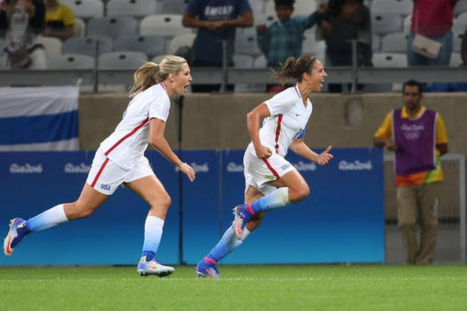 Carli Lloyd, celebrates after scoring just 9 minutes into the match.