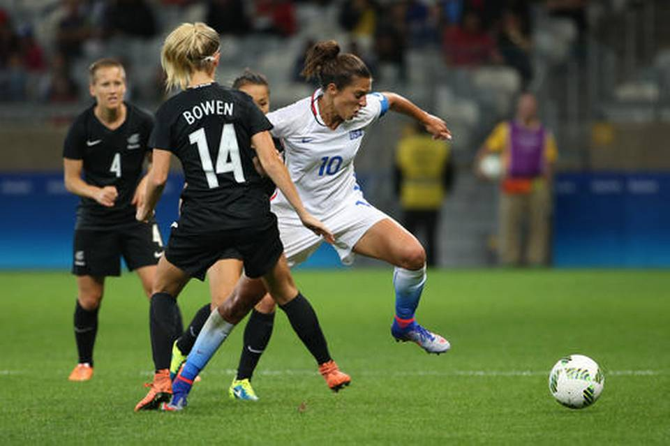 Carli Lloyd shows off her skills against New Zealand's Katie Bowen.